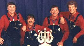 Rural Route 4 in 1986, pictured (left to right): Jim Bagby, Willard Yoder, Calvin Yoder, Don Kahl.