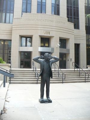 This statue, located in front of the police communications building, has sparked years of controversy in Kansas City about art and interpretation.