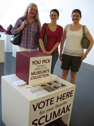 Museum visitors Joan Newell, Jennifer Baxter, and Rachel Newell after voting for their favorite Scumaks.