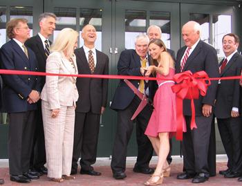 Jacques d'Amboise, former principal dancer of the New York City Ballet and colleague of Todd Bolender, and Kimberly Cowen, Kansas City Ballet company dancer, cut the ribbon to open the Todd Bolender Center for Dance & Creativity.