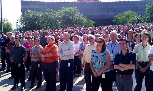 Burns-McDonnell employees learn of a thousand  new-hire colleagues at  company  HQ in Kansas City.(Click to  enlarge.)