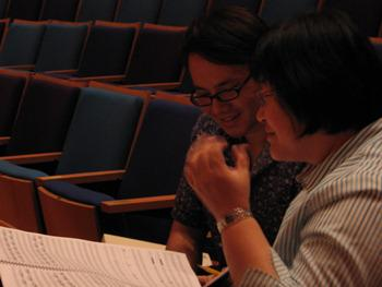 Narong Prangcharoen (UMKC Conservatory alum) and Chen Yi take notes on the score during the Kansas City Symphony rehearsal, September 21, 2011.