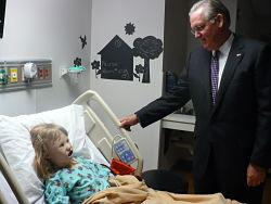 Mo. Governor Jay Nixon tends to 8-year-old Simone Jones, a robopatient at Metropolitan Community College's virtual hospital.