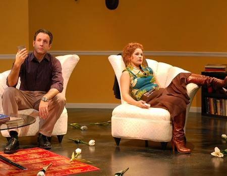 "Brian Paulette (as Michael Novak) and Cinnamon Schultz (as Veronica Novak) in Unicorn Theatre and Kansas City Actors Theatre?s co-production, ""God of Carnage"" by Yasmina Reza, translated by Christopher Hampton."