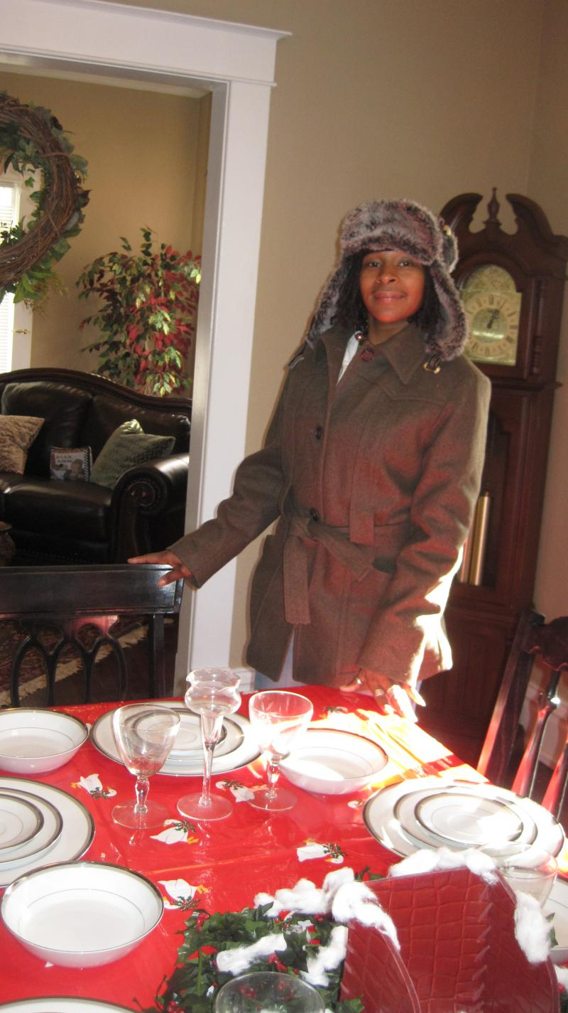 Kameela Patterson, Freedom House resident, stands at the dinner table. Residents all eat together in a family setting.