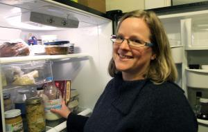 Jill Lucht, of Columbia, Mo., reads the ingredient lists on the food in her refrigerator.