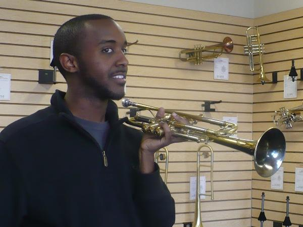 Musician Hermon Mehari tests out a BAC custom-made trumpet.