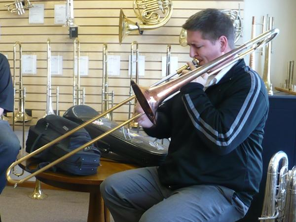 Musician Ryan Heinlein plays a tune on a BAC trombone.