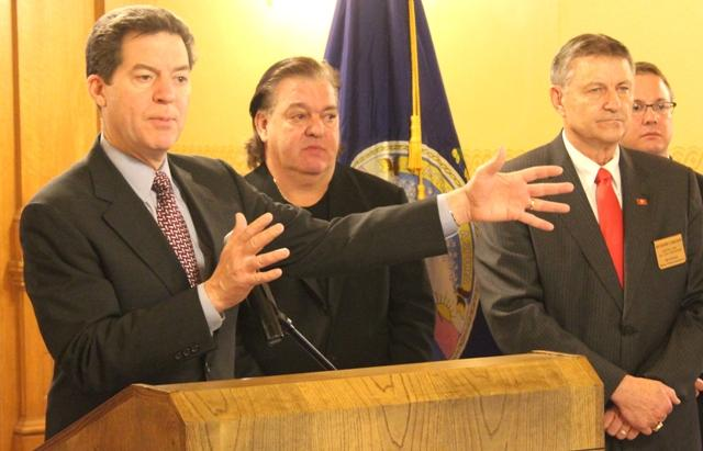 Governor Sam Brownback speaks at a rally in favor of his tax plan.
