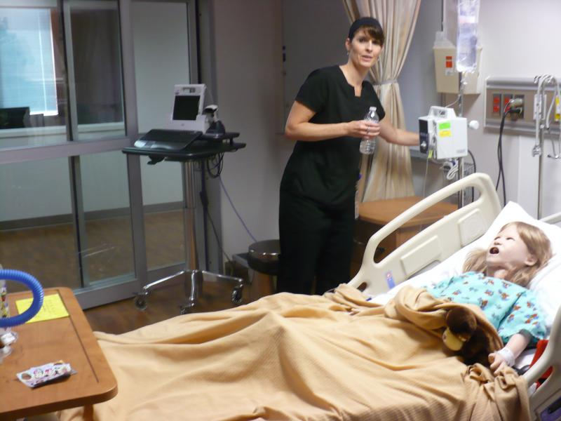 Melissa Trybom hooks up MCC's simulation lab.