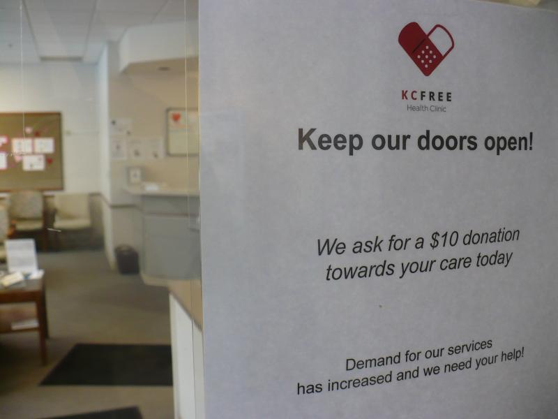 The Kansas City Free Health Clinic recently posted a sign on its door, requesting patients give a $10 donation with their visit.