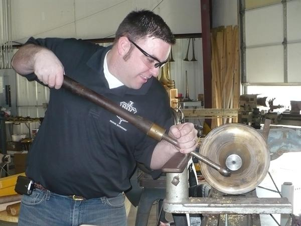 Mike Corrigan hand-spins a bell, a process that's rarely used anymore.
