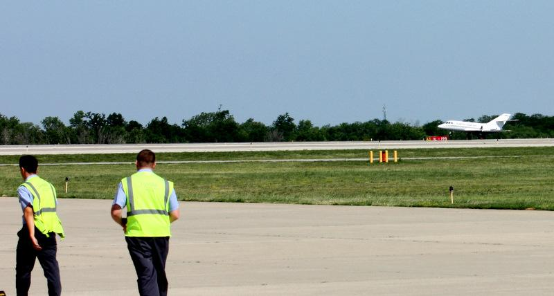 KCI ground crews hurry to meet inbound jet, about to land, carrying body of SGT Michael Knapp.