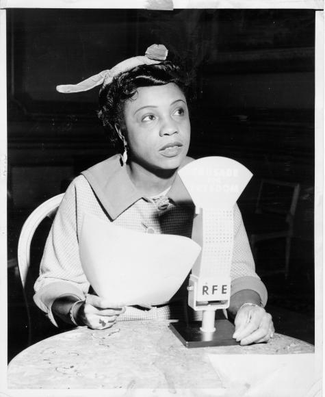 Photograph of an unidentified actress reading a script for a radio performance.
