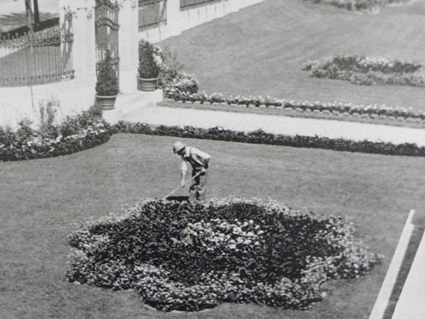 An early 20th century image of part of the garden at Corinthian Hall.