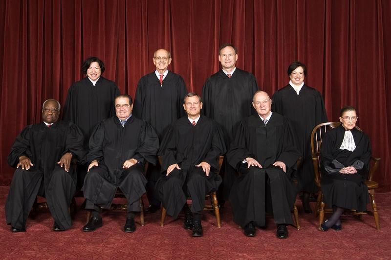 The nine members of the U.S. Supreme Court. Bottom row (l-r), Clarence Thomas, Antonin Scalia, John Roberts, Anthony Kennedy, Ruth Bader Ginsburg. Top row: (l-r) Sonia Sotomayor, Stephen Breyer, Samuel Alito, Elana Kagan