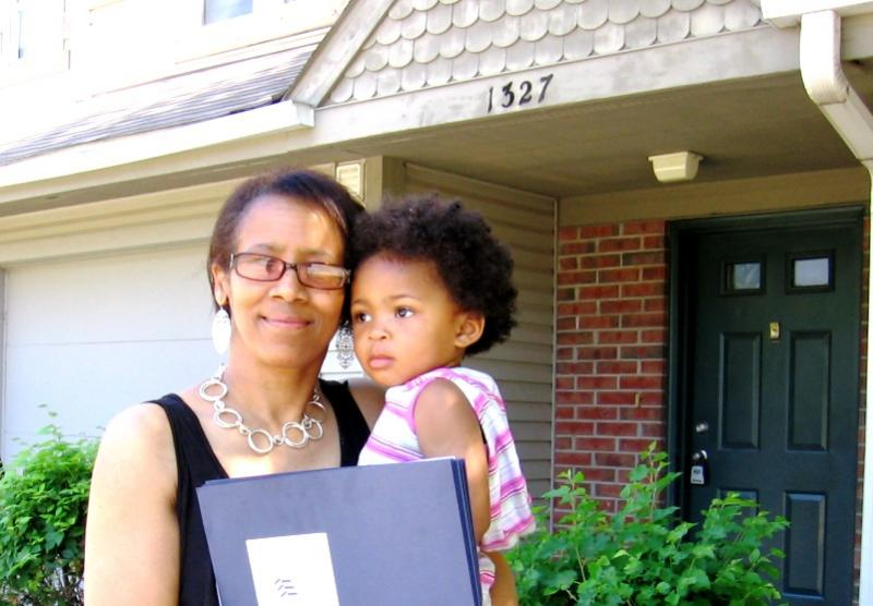 Felicia Green, with granddaughter, is an original  and current tenant of Squier Park Townhomes, glad for a million dollar rehab