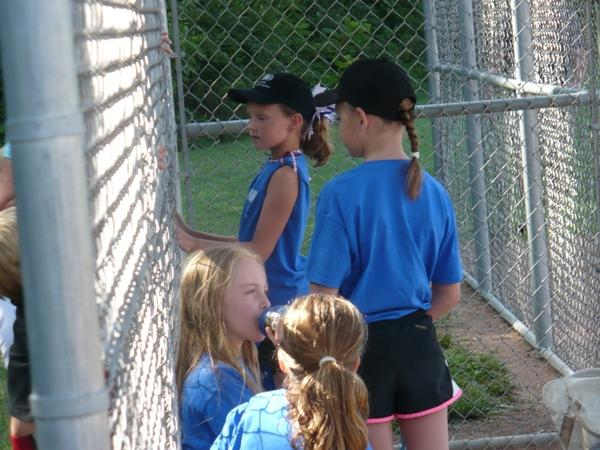 A girls t-ball team gets ready to take the field at Leawood City Park.