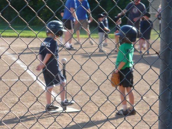 Two t-ball players chat between innings at Leawood City Park.