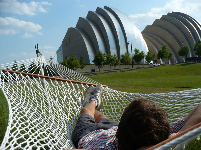"Artist Jarrett Mellenbruch views the performing arts center from one of a dozen hammocks that make up his public art piece called ""Float."""