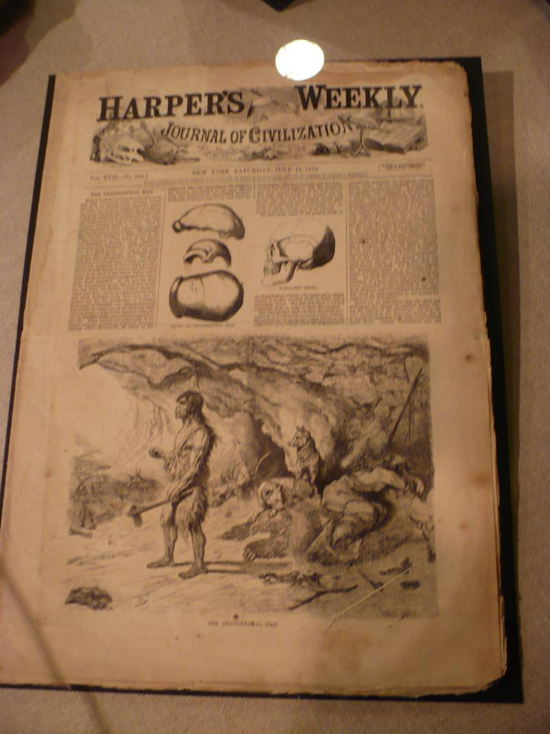 A Harper's Weekly newspaper depicts early man as living in caves and using tools.