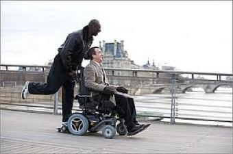 "Omar Sy & Francois Cluzet in flight in ""The Intouchables."""