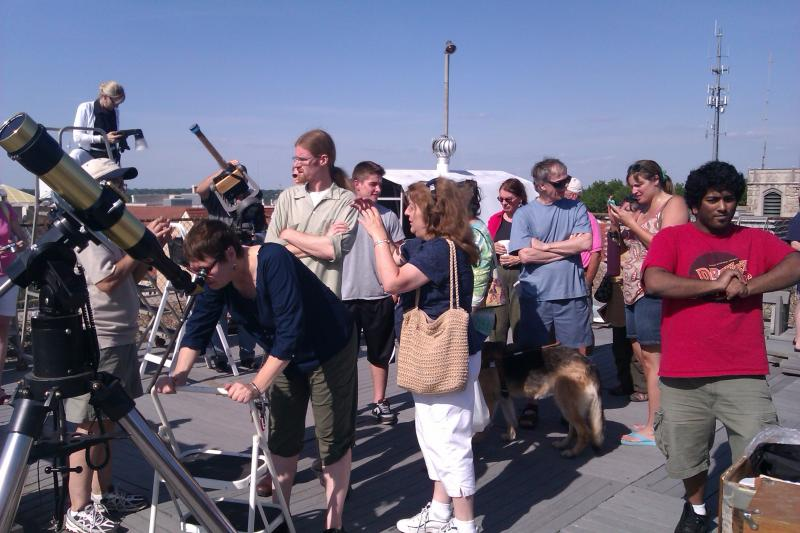 People crowd around the scope at Warko to catch the Venus Transit.