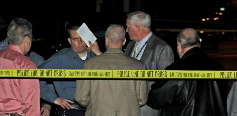 Kansas City homicide detectives at 2011 death scene. Critics complain police won't reveal names of most dangerous people.