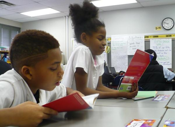 Area students reading in the classroom.