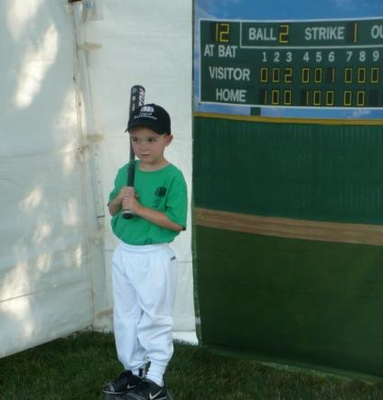 T-ball player Alex poses for his team portrait before a game at Leawood City Park.