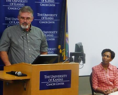 Bill Witaker (pictured left), a cancer survivor, spoke at yesterday's official announcement. KU Chancellor Bernadette Gray-Little listened next to him.