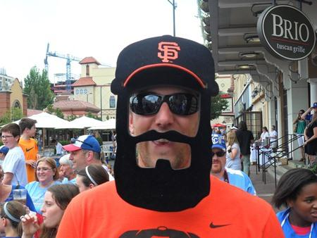 A picture of San Francisco Giants fan Matt Eichinger of York, Nebraska, attending the red carpet parade Tuesday at the Country Club Plaza.