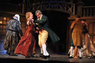 "Peggy Friesen (in red dress) awhirl in KC Rep's ""Xmas Carol""."