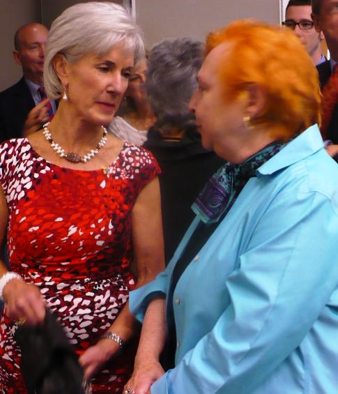 HHS Secretary Kathleen Sebelius (left) spoke with recently retired KU Med Center dean, Barbara Atkinson (right), following yesterday's announcement.