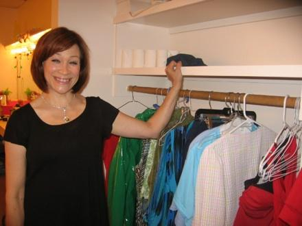 "Cheryl Weaver in the American Heartland dressing room with some of her costumes for ""BINGO: The Winning Musical""."