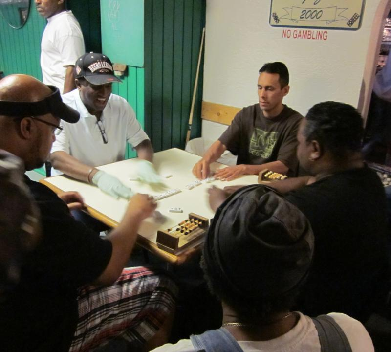 Dominoes at the Green Duck Lounge. Travis Newsome in white shirt. Jerome Wooten in black.