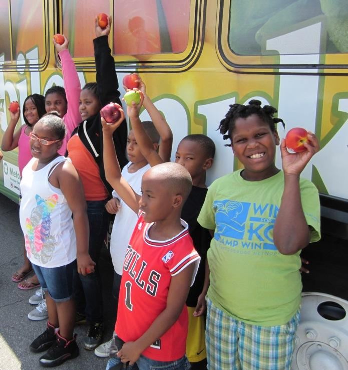 Fourth graders at the Boys & Girls Club visit Truman's new mobile grocery store.