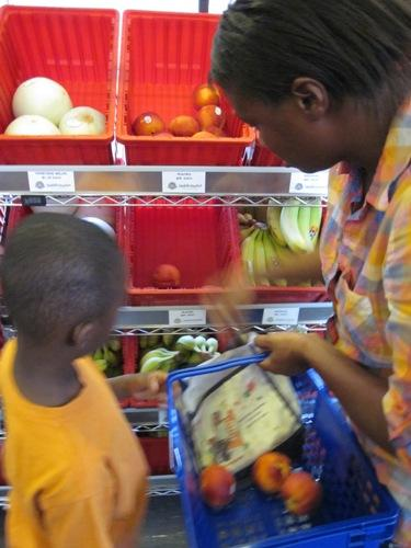 Latonya Jordan stopped by the market while enrolling her son, Dante, at the Boys and Girls Club.  Jordan says the produce here is a lot cheaper for her than what she'd find at a regular grocery store.