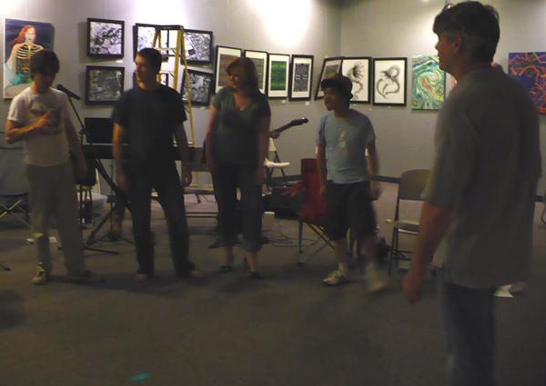 "Ry Kincaid (far left) and some of the cast of ""Pilgrimage"" during a recent rehearsal. Director Bob Paisley, at right."