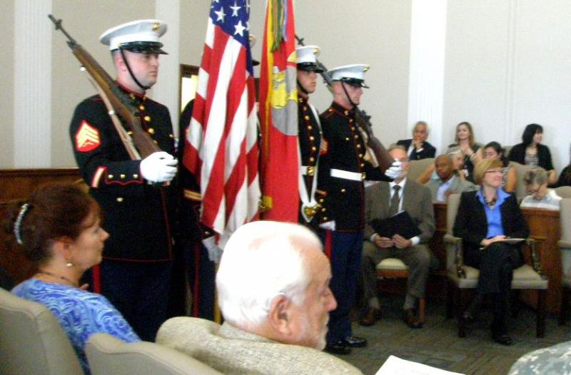 U.S. Marine Corps honor guard at ceremony dedicating new Veterans' Drug Court. Retired Jackson County Circuit Judge William Mauer and current  Judge Peggy Stevens McGraw prepare to speak.