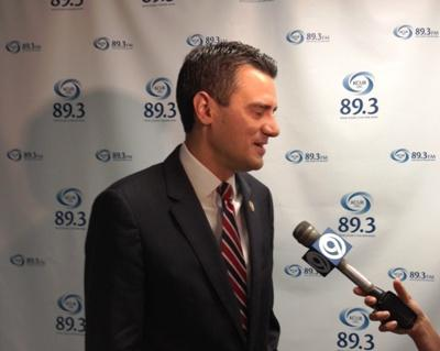 Kevin Yoder fields questions from reporters at KCUR studios.