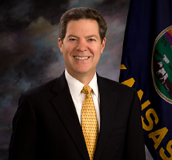 Kan. Gov. Sam Brownback and other supporters of an impending, massive tax cut say it will provide a boost to the economy.