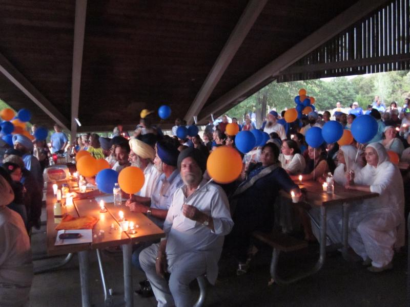 Sikhs hold a vigil in Shawnee Mission Park.