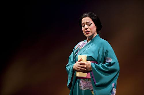 Cio-Cio-San, known as Butterfly, played by Elizabeth Caballero, holds a letter from her husband Lt. B. F. Pinkerton.