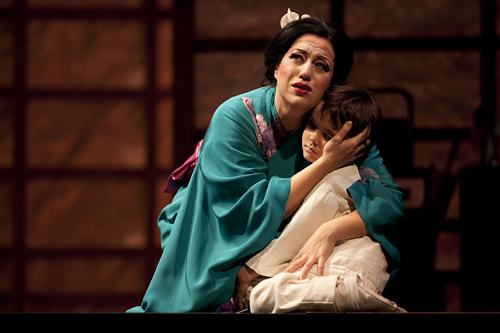 Cio-Cio-San, known as Butterfly, embraces her son Sorrow, played by Nick Rohaus.