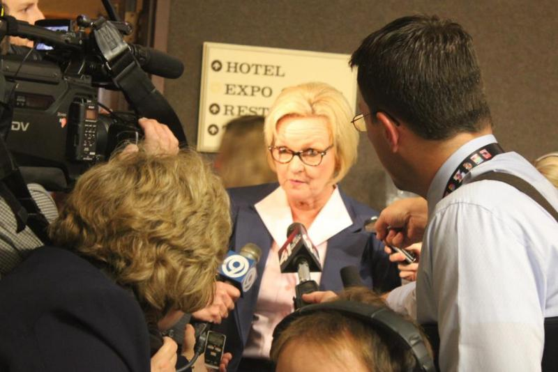 Claire McCaskill is swarmed by reporters.