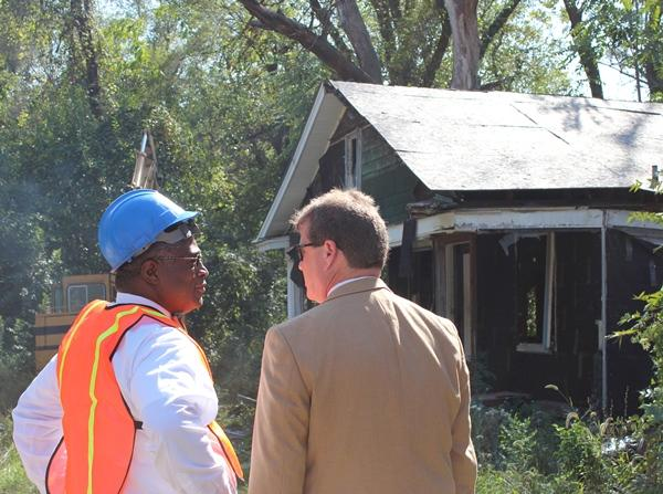 Kansas City Mayor Sly James (at left) prepares for demolition duty at 4406 Brooklyn in Kansas City, Mo.