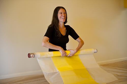Carrie Scanga laughs as she rolls extra panels.