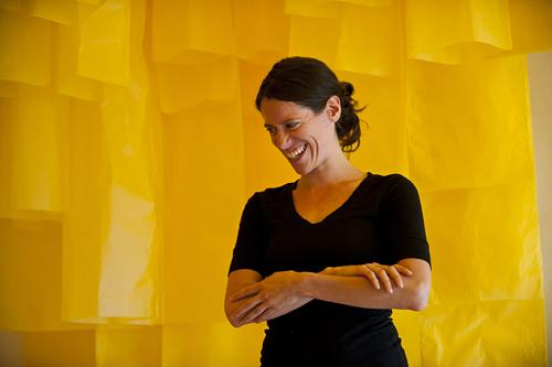 Soft folds of gold surround Carrie Scanga  in the transformed space at PLUG Projects gallery.