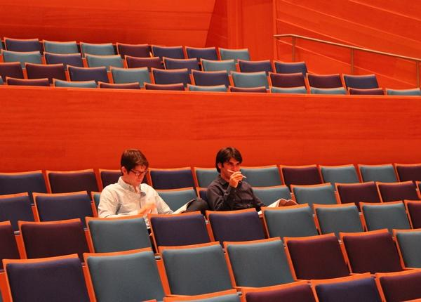 """Composer Adam Schoenberg and Assistant Conductor Aram Demirjian in Helzberg Hall at a Kansas City Symphony rehearsal of Schoenberg's """"Finding Rothko (2006)."""" It was commissioned by music director Michael Stern."""